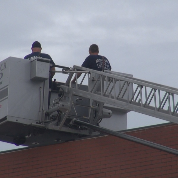 Bridgeport Fire Department works on roof