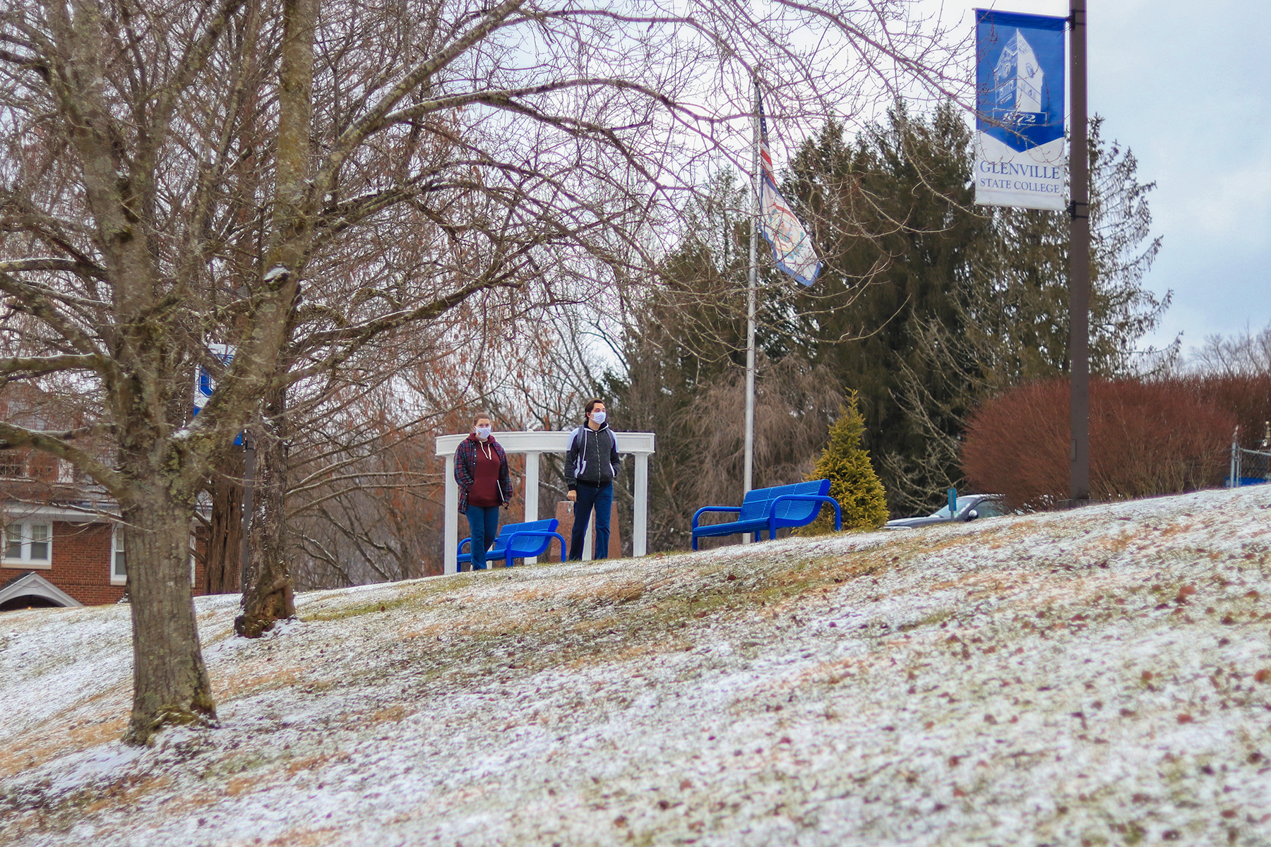 Students walk across Glenville State College's snowy campus on Tuesday, January 19, the first day of the spring 2021 semester